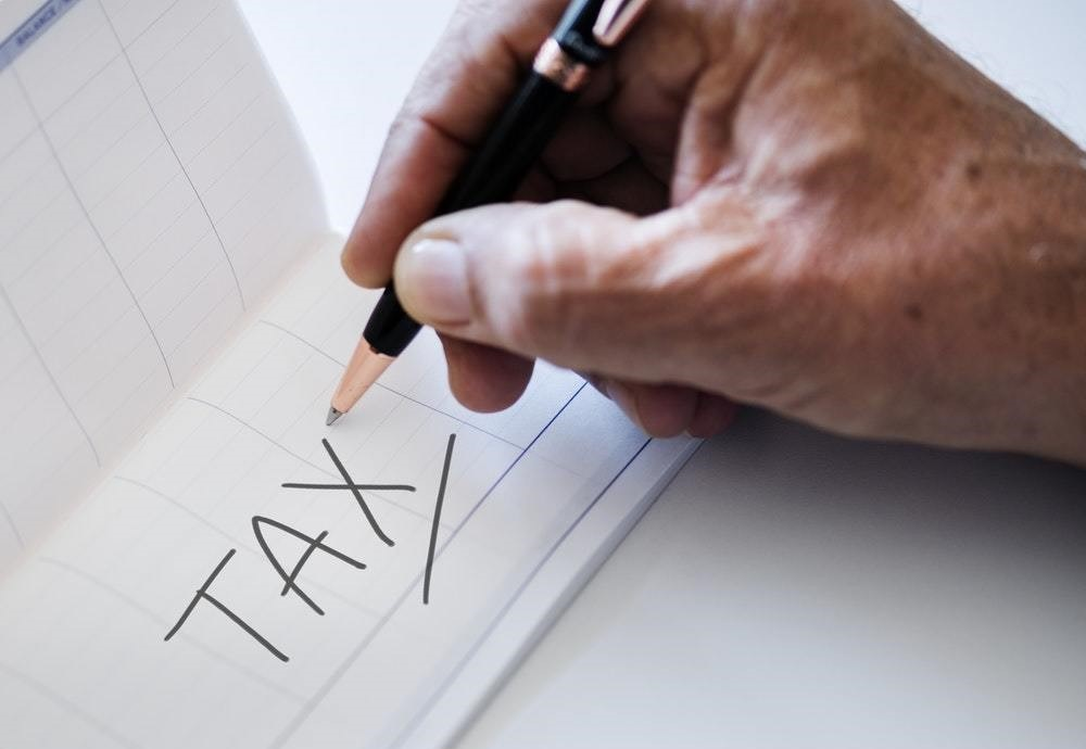 Person writing tax