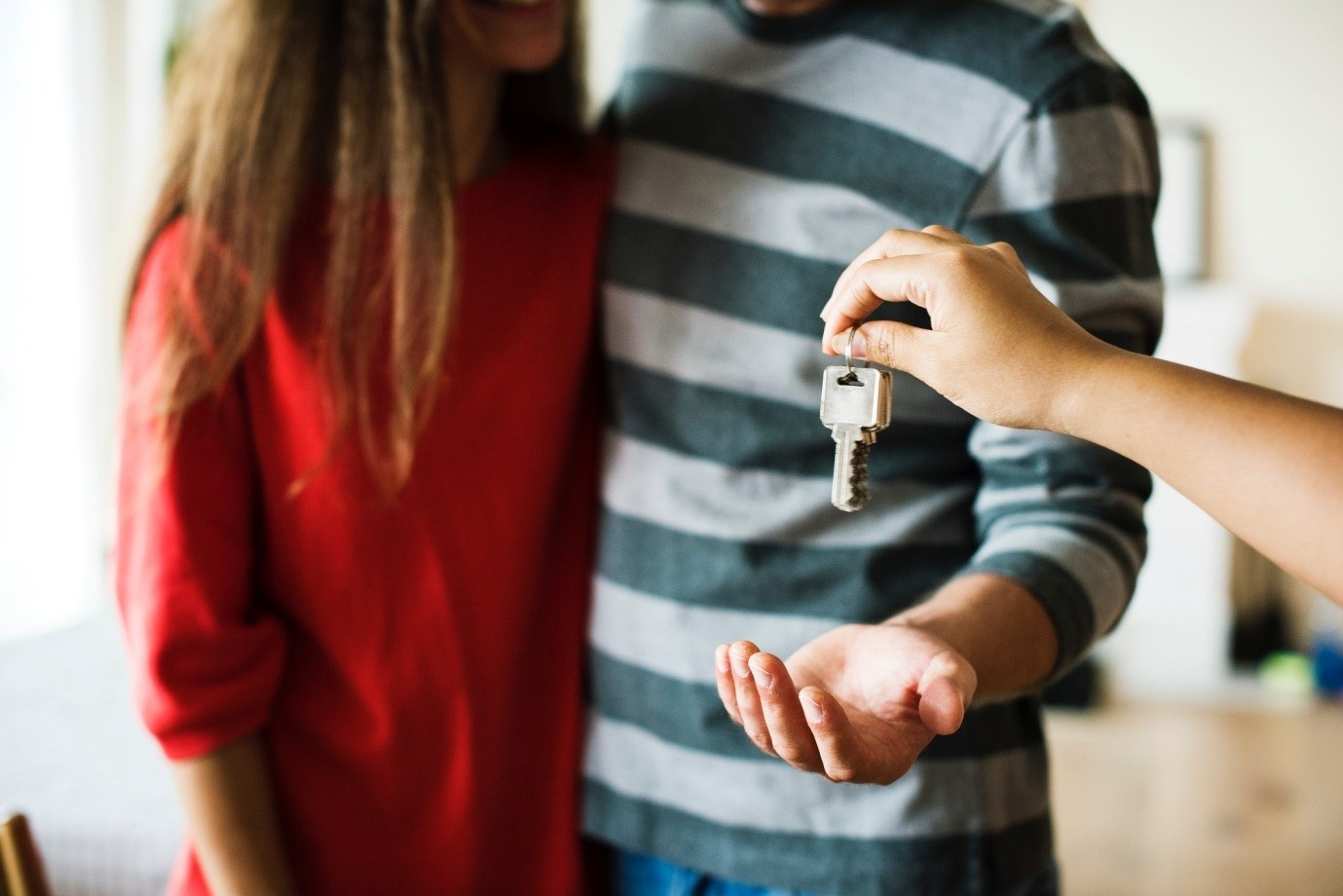 A couple is taking a key